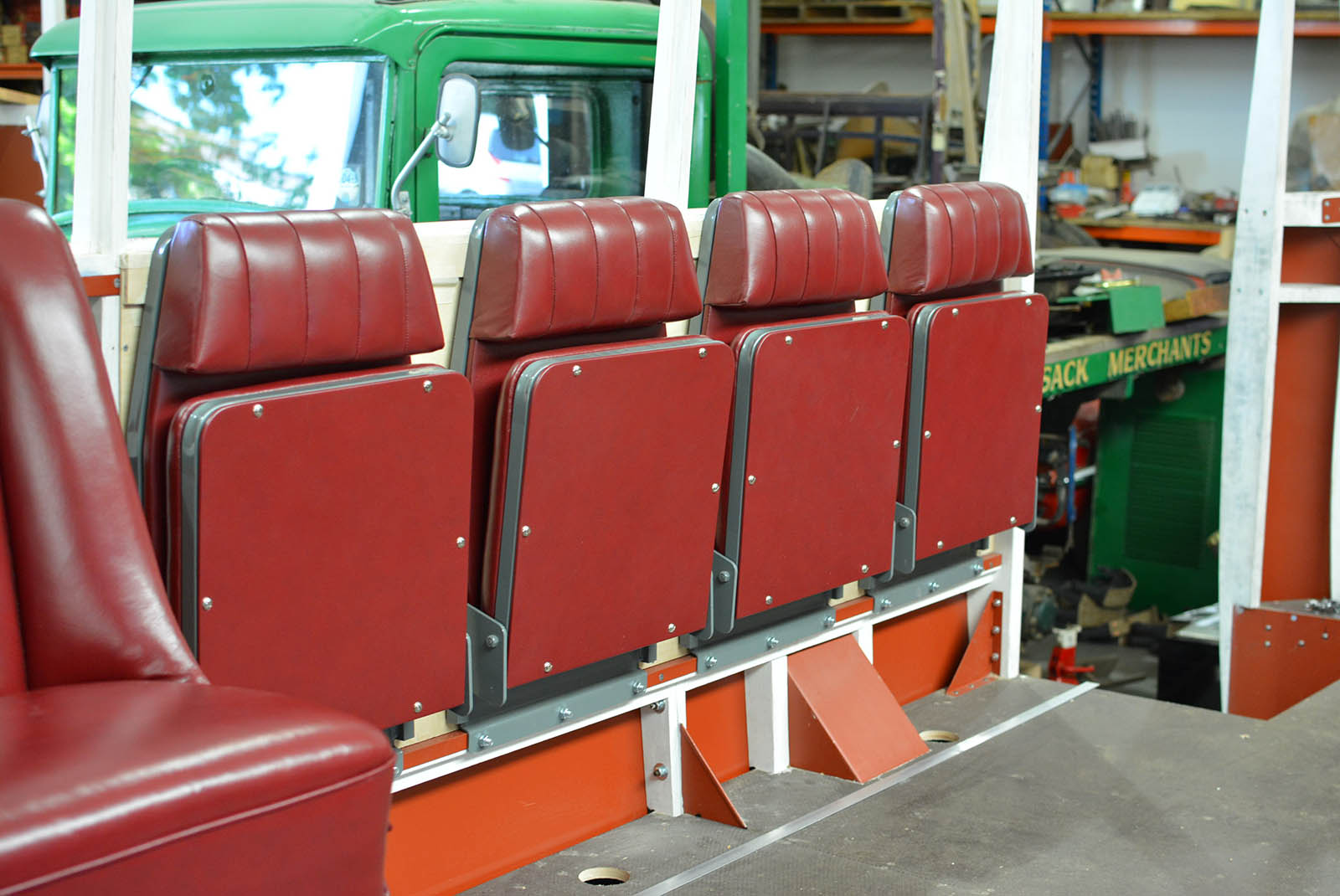 Modern flip down seats, re-trimmed to fit within the period style of the 1934     Leyland Cub disability bus